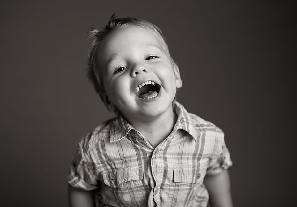 young boy laughing